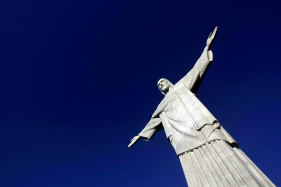 "The statue of ""Christ the Redeemer"" is seen atop scenic Corcovado mountain during a restoration ceremony in Rio de Janeiro June, 30, 2010. The famous statue of Christ with his arms wide open that ""cariocas"" and tourists are used to seeing from various points has been covered up the last four months by 89 tons of scaffolding. REUTERS/Bruno Domingos (BRAZIL - Tags: SOCIETY RELIGION TRAVEL) - RTR2FY2E"
